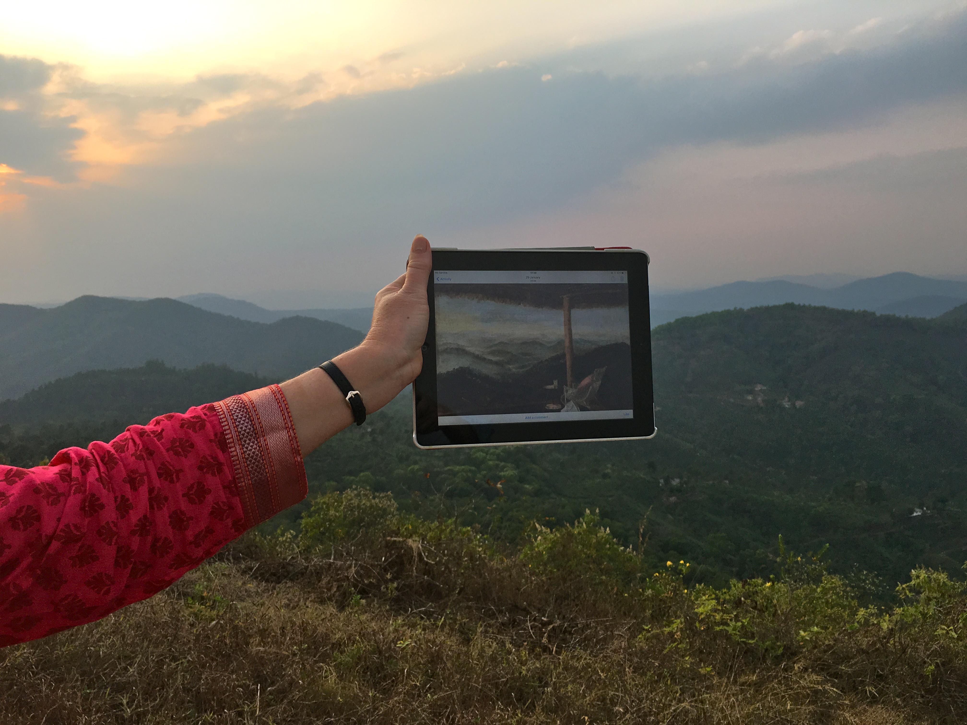 Bay holding Ellens painting Elephant Hill